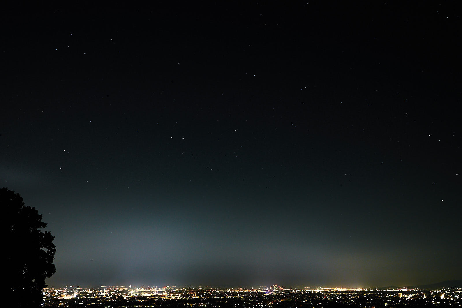 Night sky over Vienna, Austria with light pollution from city lights